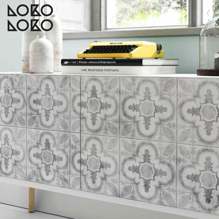 Vinyl to decorate sideboard doors with design of grey ceramic tiles of vintage style