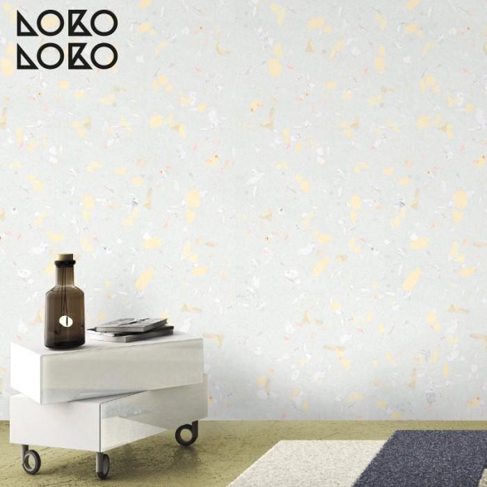 Vinilo de imitación de texturas de terrazo amarillo claro para decorar la pared