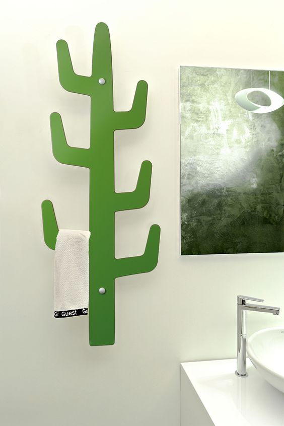 Ideas para decorar tu casas con cactus for Perchero electrico para bano