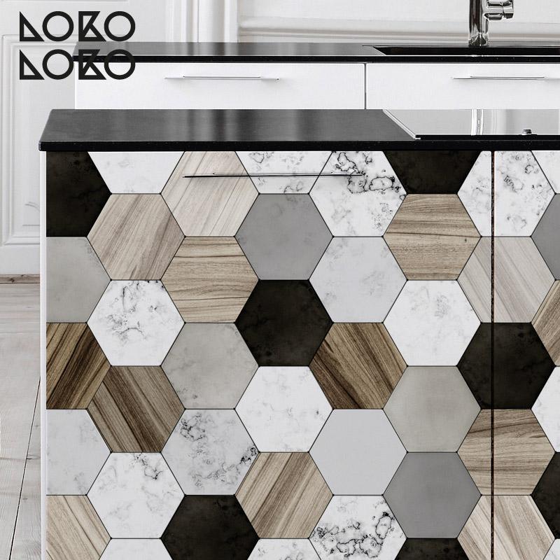 Decora tus suelos y muebles con los nuevos vinilos con for Forrar azulejos cocina