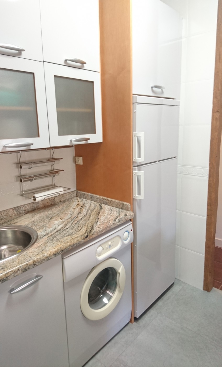 Lavadora forrada con vinilo para muebles